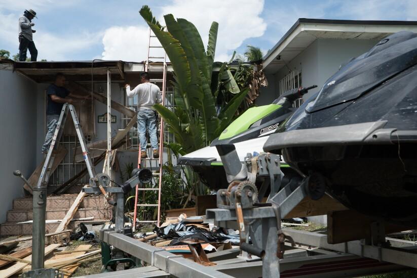 Contractors prepare a home ahead of Hurricane Irma in Miami, Florida.