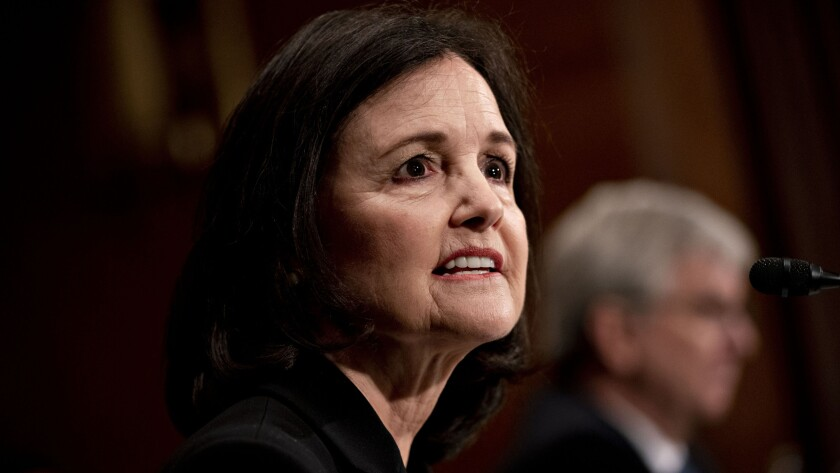Judy Shelton, President Trump's nominee for governor of the Federal Reserve, speaks during a Senate Banking Committee confirmation hearing in Washington on Feb. 13, 2020.