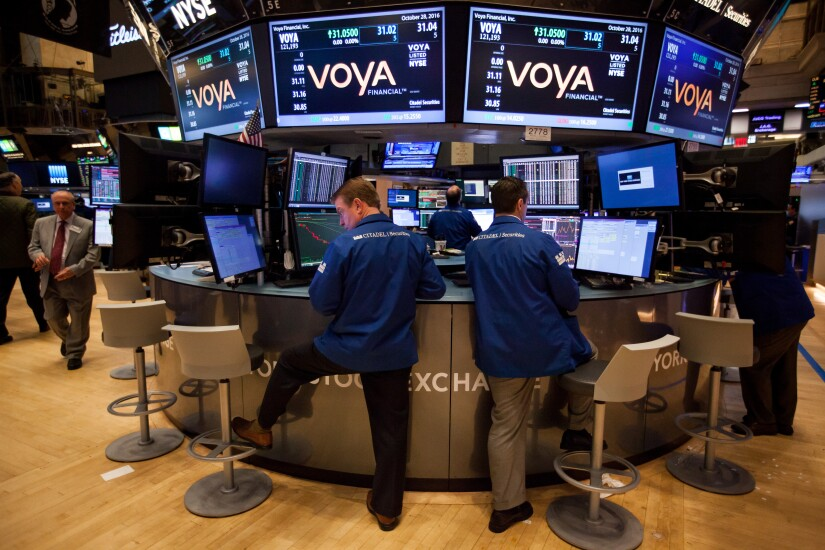 Voya Financial Advisors President Tom Halloran says the firm is inclined to seek an acquisition in order to add a digital platform to its offerings.