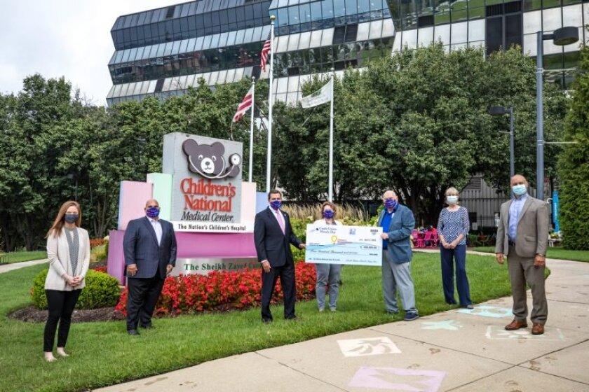 Credit union representatives present a check at Children's National Medical Center in Washington