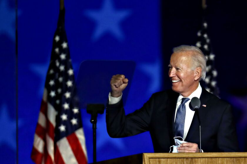 Joe Biden, 2020 Democratic presidential nominee, gestures while arriving during an election night party in Wilmington, Delaware, U.S., on Wednesday, Nov. 4, 2020. Donald Trump falsely declared early Wednesday he had won re-election against Biden and said he would ask the Supreme Court to intervene, even as several battleground states continue to count votes. Photographer: Stefani Reynolds/Bloomberg