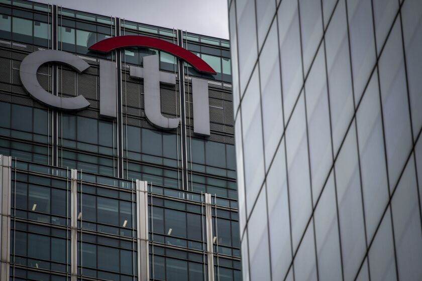 A sign sits on top of the skyscraper housing the Citigroup Inc. offices at 25 Canada Square in the Canary Wharf business, financial and shopping district in London, U.K.