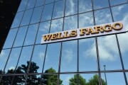 Wells Fargo shiny glass signage displayed on the exterior of a bank branch in Dallas on Monday, July 10, 2017 Bloomberg News