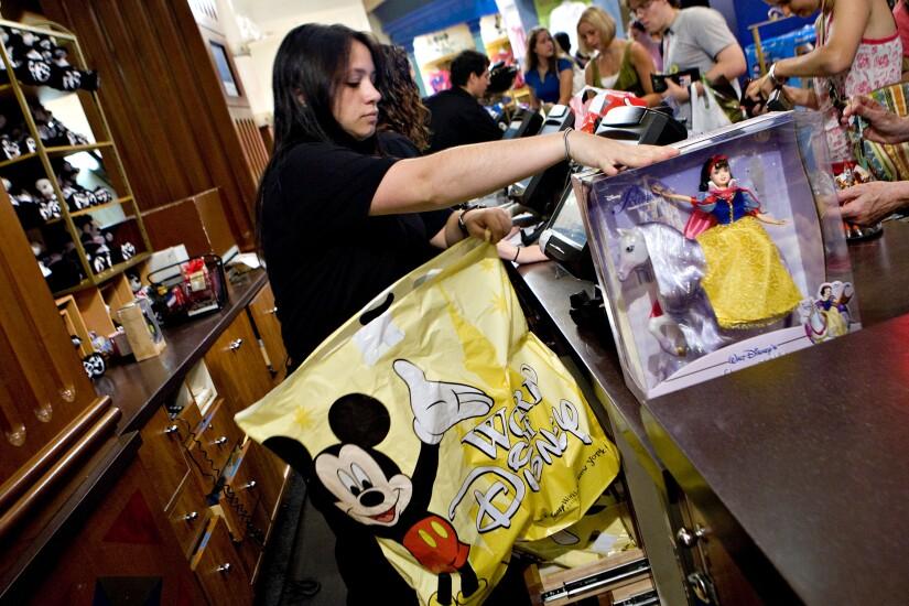 Disney cashier with bag