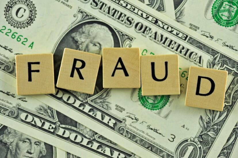 fraud-over-dollar-bills-36201847-adobe.jpeg