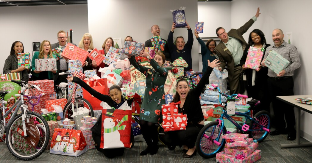 """Michigan First CU senior management and employees donated collected and donated holiday gifts to kids through """"Goodfellows"""" program in December 2017."""