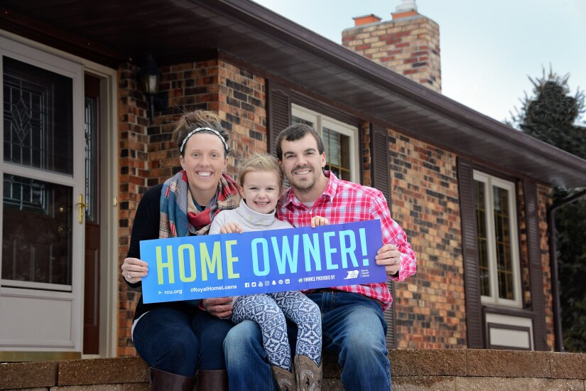 Trevor and Sarah Ellefson with their daughter, Rylie, became 'home sweet homeowners' with a little help from Royal Credit Union.