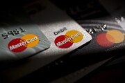 Mastercard credit cards are arranged for a photograph.