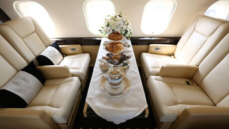 A table set for dining sits aboard a Bombardier Inc. Global 6000 business jet at the Singapore Airshow held at the Changi Exhibition Centre in Singapore.