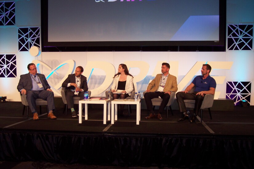 A panel of auto dealers spoke during the 2019 CU Direct Drive conference in Las Vegas. From left: Scott Stephens, general sales manager, Chapman Auto Group, Las Vegas; Oliver Young, director of sales and marketing, Young Automotive Group, Utah; Hannah Lutz, editor and reporter, Automotive News; Nathan Post, general sales manager, Rusty Wallace Auto Group, Tennessee; James Knudson, general sales manager Dwayne Lane Auto Family Dealerships, Washington.