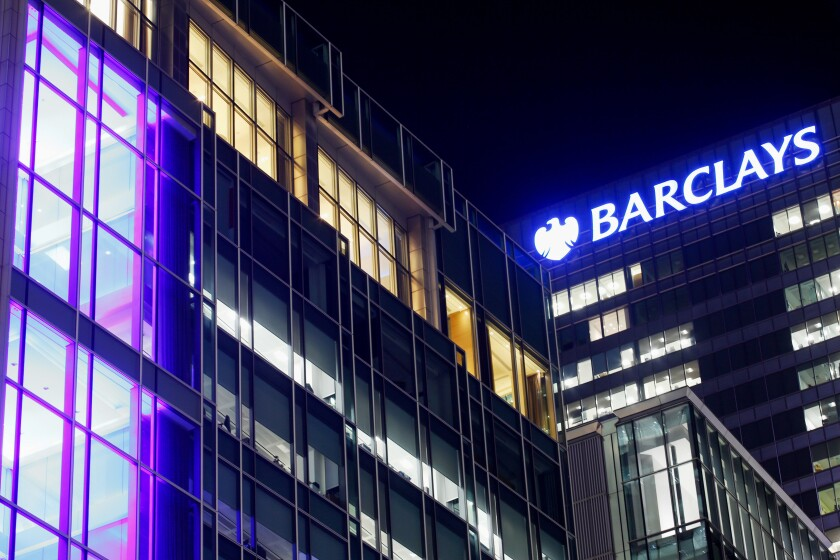 Barclays bank neon sign at night