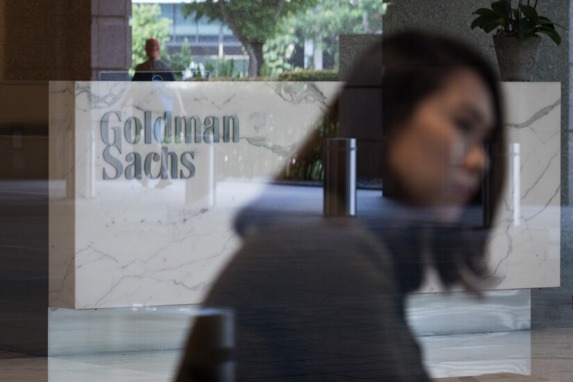 The Goldman Sachs Group Inc. logo is displayed in the reception area of the One Raffles Link building, which houses one of the Goldman Sachs (Singapore) Pte offices, in Singapore, on Saturday, Dec. 22, 2018. Singapore has expanded a criminal probe into fund flows linked to scandal-plagued 1MDB to include Goldman Sachs Group, which helped raise money for the entity, people with knowledge of the matter said. Photographer: Nicky Loh/Bloomberg