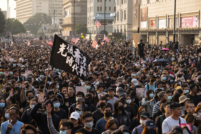 "Demonstrators occupied the street during a protest in the Tsim Sha Tsui district of Hong Kong, China, on Sunday, Dec. 1, 2019. China said it ""strongly"" opposed an op-ed by United Nations High Commissioner for Human Rights Michelle Bachelet, accusing her of meddling in the country's affairs and emboldening Hong Kong protesters to commit violence. Photographer: Chan Long Hei/Bloomberg"