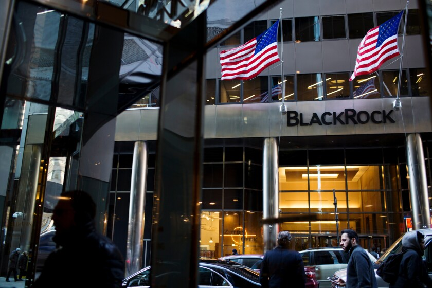 Pedestrians pass in front of BlackRock Inc. headquarters in New York, U.S., on Friday, Jan. 11, 2019. BlackRock Inc. is scheduled to release earnings figures on January 16. Photographer: Gabriella Angotti-Jones/Bloomberg