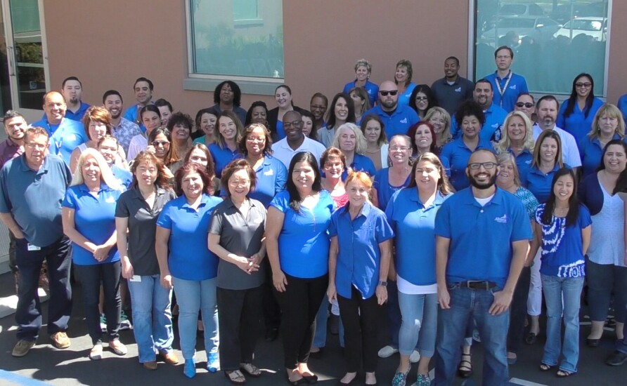 Altura Credit Union's senior staff and employees pose for a group picture.