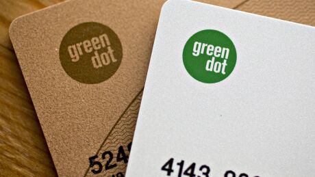 A Green Dot Corp. prepaid Mastercard Inc. card and a Green Dot Corp. Visa Inc. debit card, right, are arranged for a photograph in Washington, D.C., U.S., on Thursday, Feb. 15, 2018.