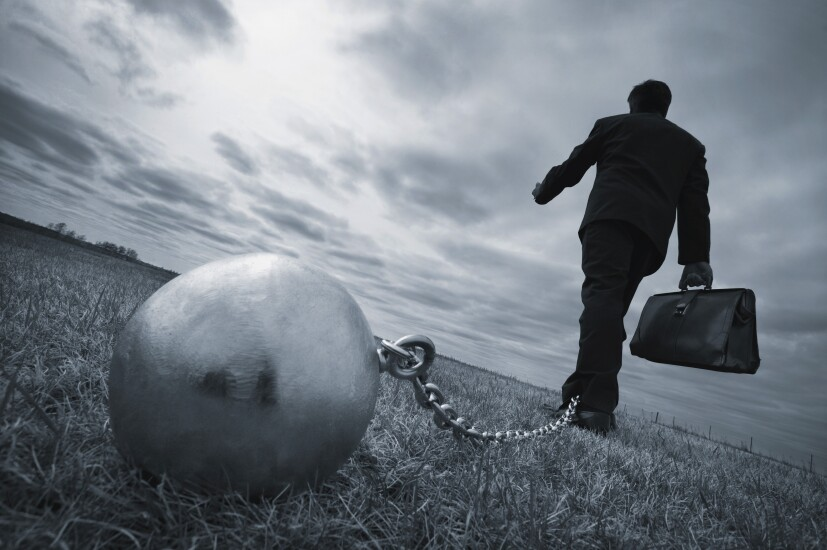 bizman-ball-and-chain-23966013-adobe.jpeg