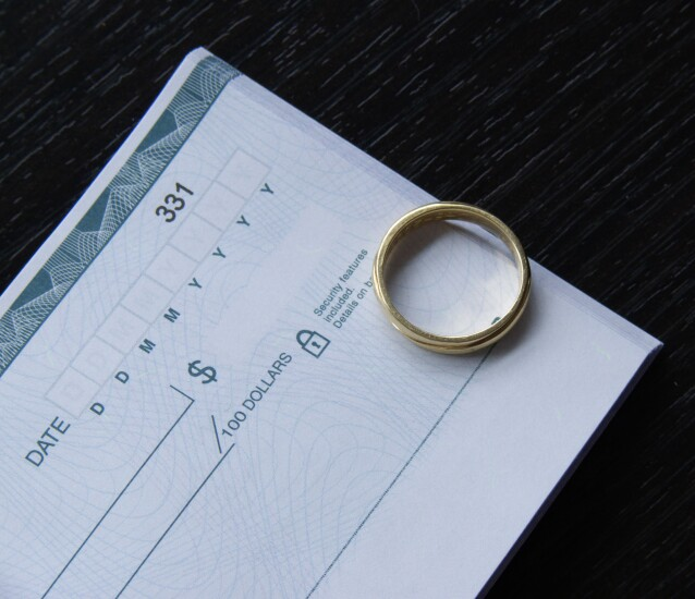 Wedding ring and checkbook