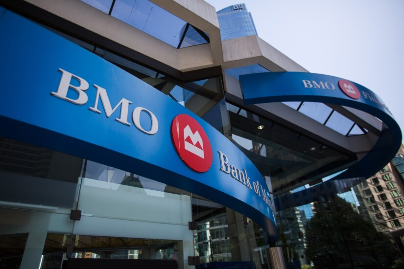Bank of Montreal signage is displayed outside a branch in Vancouver.