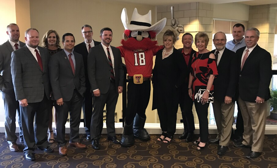 Texas Tech FCU's board and executive team pose with mascot, Raider Red