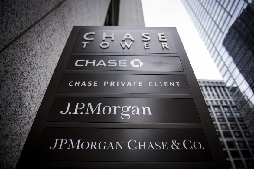 Close up of signage stands on display outside the JPMorgan & Chase Tower in downtown Chicago, Oct. 7, 2017