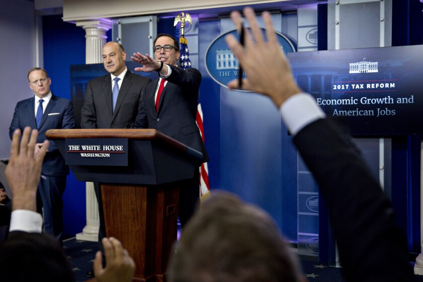 Gary D. Cohn, left, the director of the National Economic Council, and Treasury Secretary Steven Mnuchin last week unveiled the Trump administration's plan to overhaul the tax code.