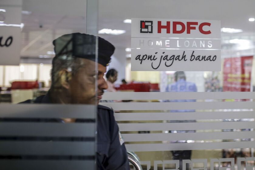 A customer exits an HDFC Bank branch in India.