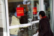 Wells Fargo customers enter and exit a branch