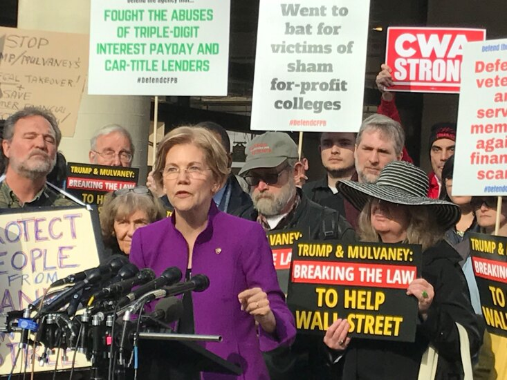 Sen. Elizabeth Warren appearing outside CFPB headquarters in a rally protesting the Trump administration's appointment of Mick Mulvaney as the agency's acting director.