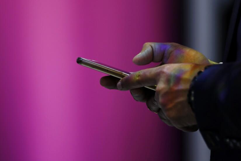 di-using-smartphone-stock-041619.jpg