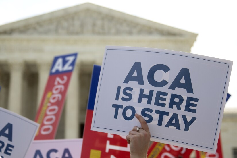 Demonstrators outside the Supreme Court in advance of the court's rulling that the ACA was constitutional