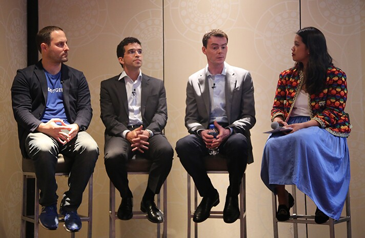 Andrew Brzezinski, vice president of Fidelity Institutional (second from right) and Massimo Young, head of data solutions at Bank of New York Mellon (third from left).