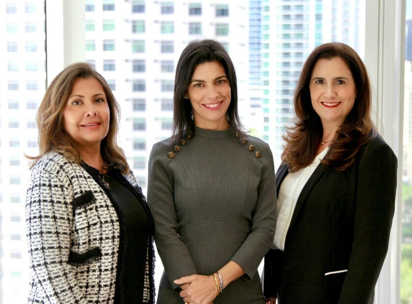 Gabriela Aguilar, Idalia Daguin, and Marina Tudela of IGM Partners join Alex. Brown in Miami.