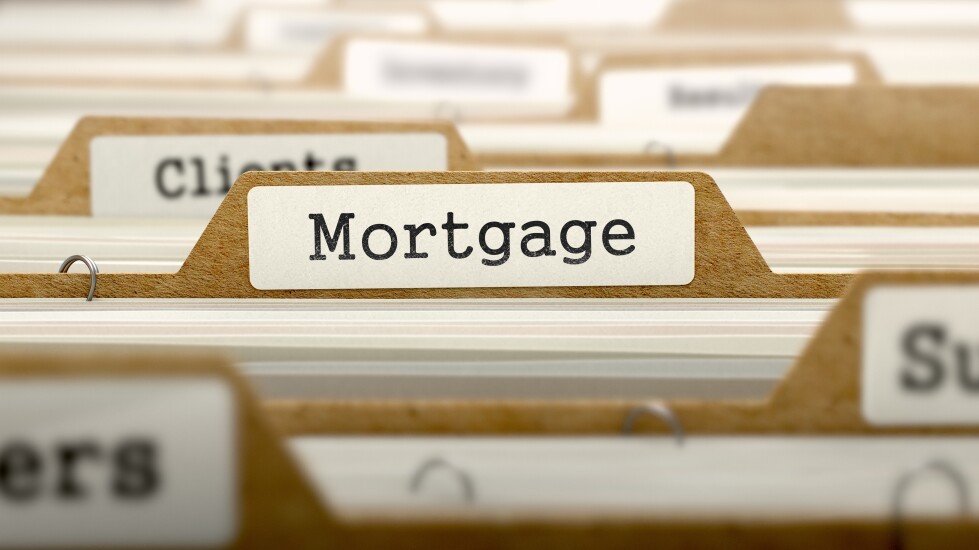 """Row of files, with one labeled """"Mortgage."""""""