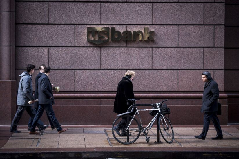 Pedestrians pass in front of a US Bancorp branch in downtown Chicago, Illinois, U.S., on Tuesday, Jan. 9, 2018. US Bancorp is scheduled to release earnings figures on January 17. Photographer: Christopher Dilts/Bloomberg.