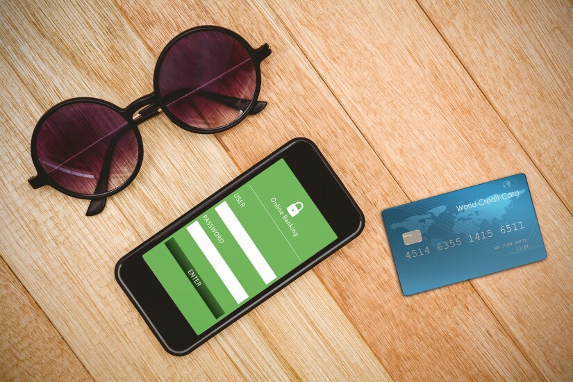 A smartphone, sunglasses and payment card