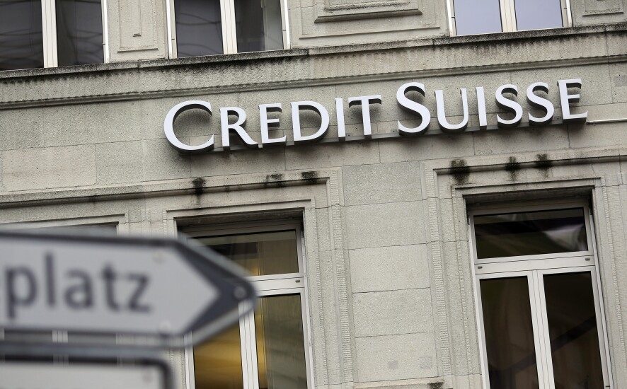 A sign hangs outside the offices of Credit Suisse headquarters in Zurich, Switzerland.
