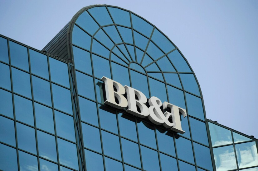 A BB&T logo hangs atop the the bank's headquarters building in Winston-Salem, North Carolina.