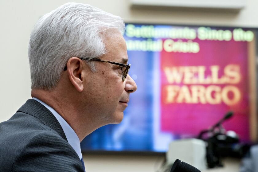 Wells Fargo CEO Charlie Scharf, seen here testifying before Congress in March, has said that resolving the bank's regulatory problems is his top priority.
