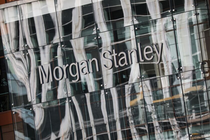 A sign sits on the Morgan Stanley U.K. headquarters in the Canary Wharf, business, financial and shopping district of London, U.K., on Friday, Sept. 18, 2020. After a pause during lockdown, lenders from Citigroup Inc. to HSBC Holdings Plc have restarted cuts, taking gross losses announced this year to a combined 63,785 jobs, according to a Bloomberg analysis of filings. Photographer: Simon Dawson/Bloomberg
