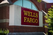 Signage is displayed outside a Wells Fargo & Co. bank branch in Schaumburg, Illinois, U.S., on Tuesday, July 10, 2018. Wells Fargo & Co. is scheduled to release earnings figures on July 13. Photographer: Christopher Dilts/Bloomberg