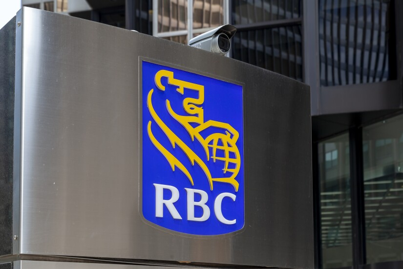 Toronto, Canada - May 16, 2020: RBC sign  in Toronto's financial district Toronto, Ontario. RBC (Royal Bank of Canada) is a Canadian multinational financial services company.