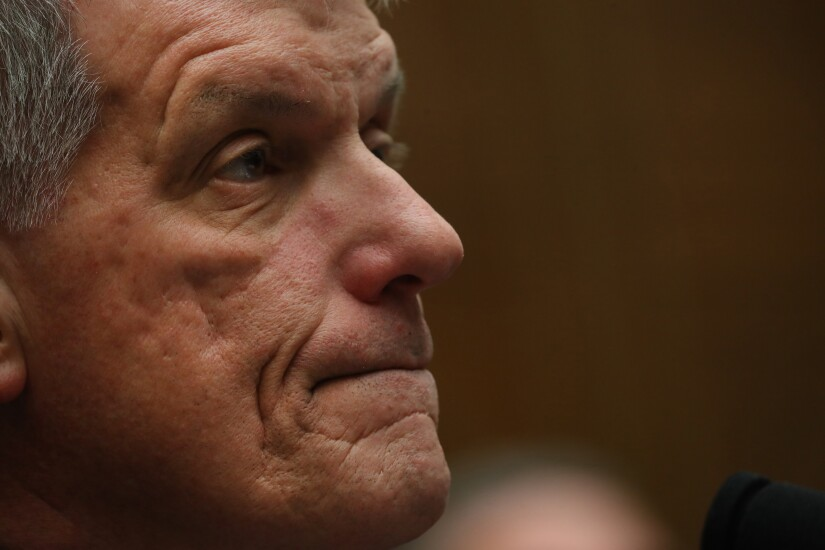 Tim Sloan, president and chief executive of Wells Fargo, waits for the start of a House Financial Services Committee hearing in Washington on March 12, 2019.