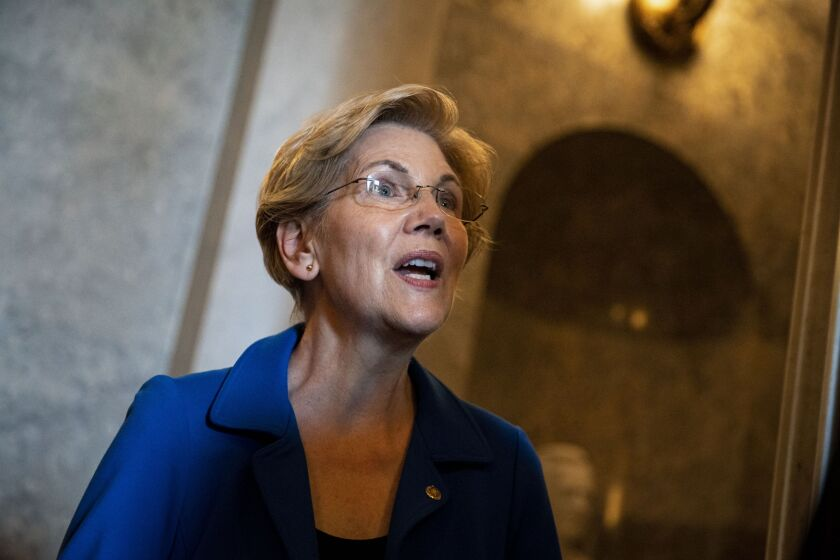 """""""Even in the face of...opposition from politicians and from industry, the agency survived [the Trump administration] and stayed strong, in part because it is built right,"""" Sen. Elizabeth Warren, D-Mass., said of the CFPB."""