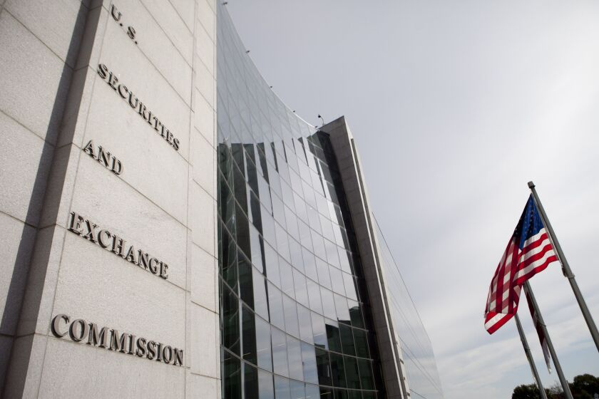 The U.S. Securities and Exchange Commission (SEC) headquarters stands in Washington, D.C., U.S., on Wednesday, Oct. 26, 2011. The SEC approved a rule requiring hedge funds and private-equity funds to reveal internal information to U.S. regulators. Photographer: Andrew Harrer/Bloomberg