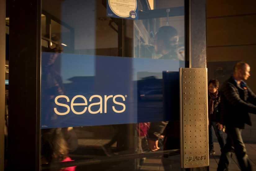 Customers enter a Sears store in San Bruno, California.
