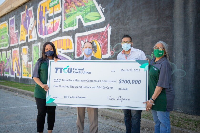 TTCU representatives pictured during a check presentation to the the Tulsa Race Massacre Centennial Commission