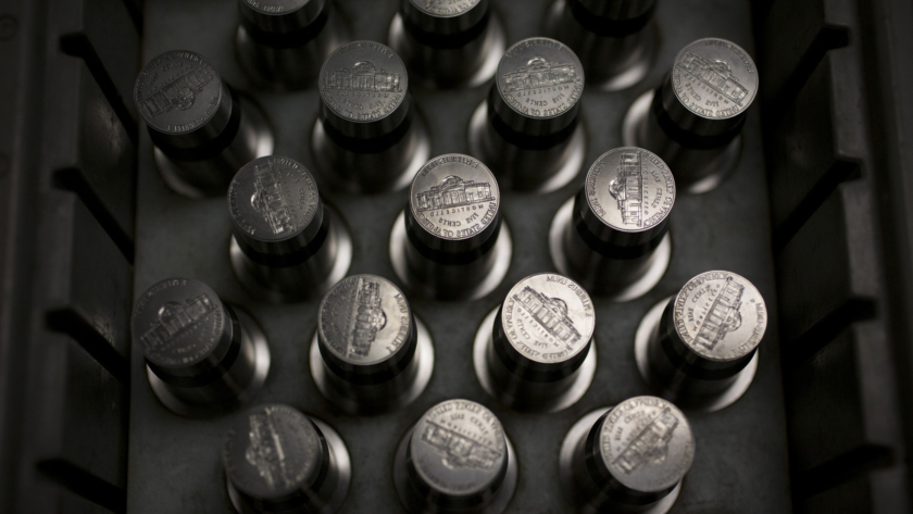 Coins. Specifically, dies used for pressing nickels sit in a tray in Pennsylvania