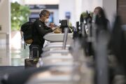 A traveler checks in at the Delta Air Lines counter in San Francisco on April 2.  Photographer: David Paul Morris/Bloomberg