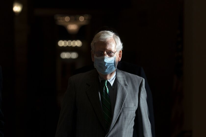 Mitch McConnell walks to the Senate Floor in Washington D.C.